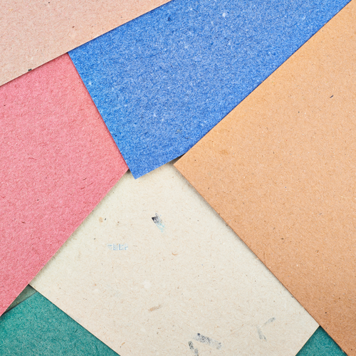 Composition of multiple cardboard paper sheets as an abstract background composition