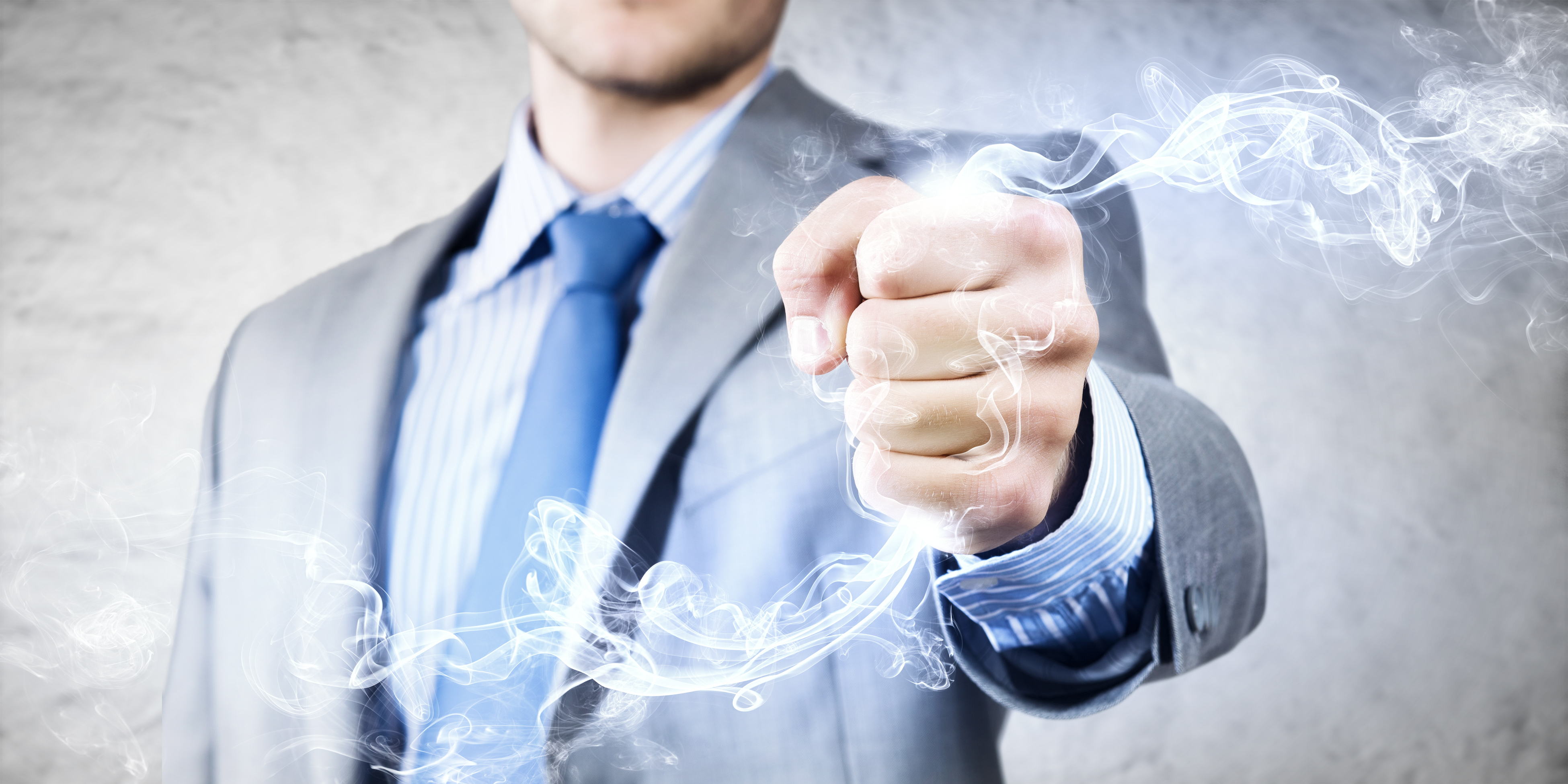 Close up image of businessman clenching fume in fist
