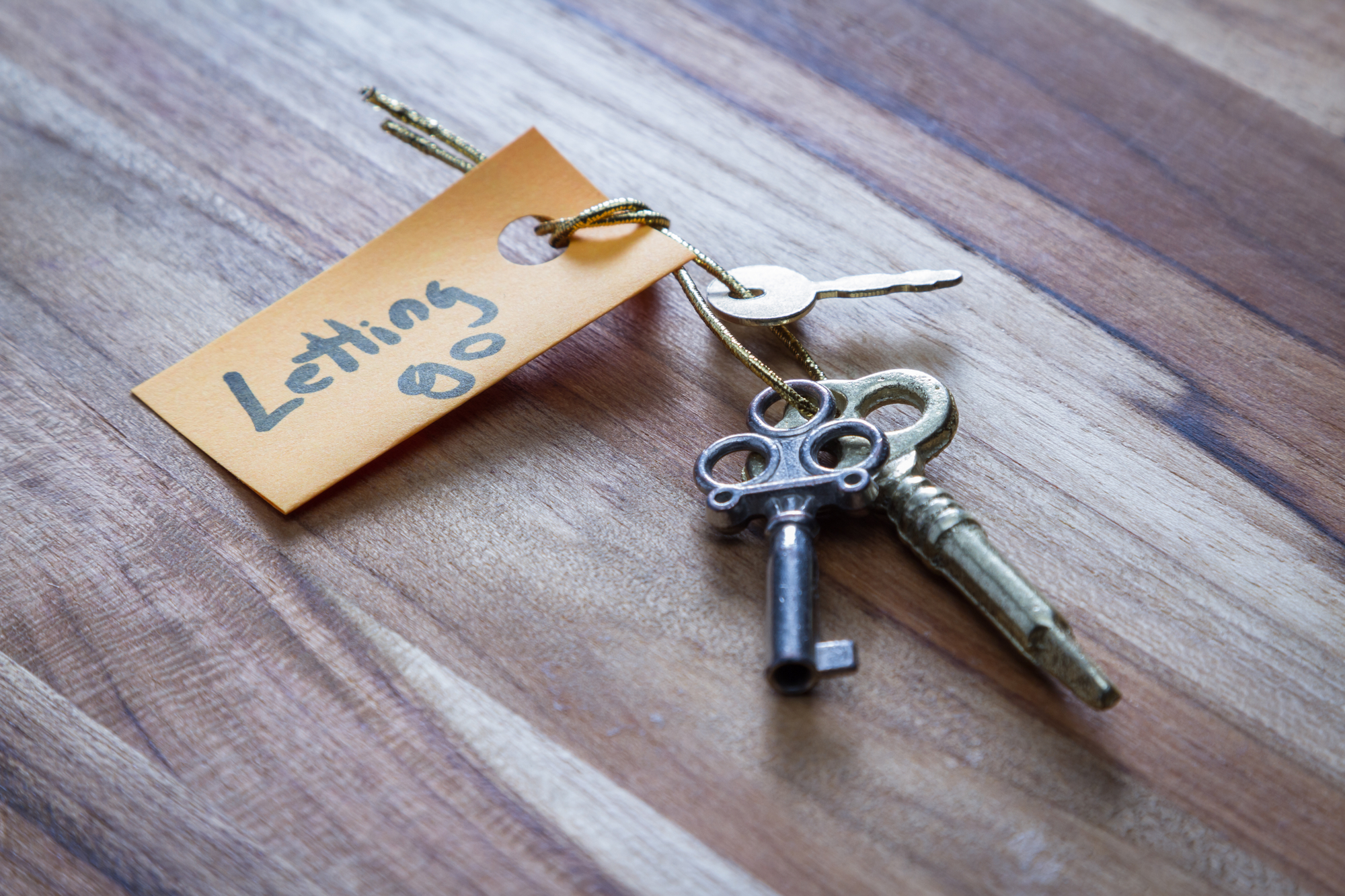 concept for a happy life using old decorative keys and a hand written tag attached by a golden cord